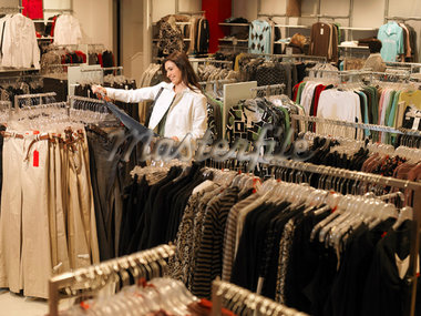 Woman Inspecting Pants in Store    Stock Photo - Premium Rights-Managed, Artist: Matthias Tunger, Code: 700-02010624