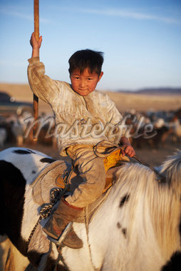 Portrait of Little Boy on Horseback, Mongolia    Stock Photo - Premium Rights-Managed, Artist: Nick Onken, Code: 700-02047055