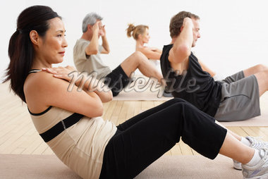 People Exercising in Studio    Stock Photo - Premium Rights-Managed, Artist: Masterfile, Code: 700-02071499