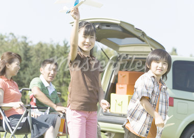 Children playing with toy plane Stock Photo - Premium Royalty-Freenull, Code: 670-02120254