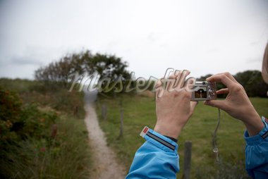 Person Taking Picture, Ameland, Netherlands    Stock Photo - Premium Rights-Managed, Artist: Derek Shapton, Code: 700-02129104