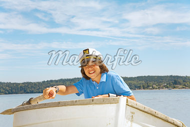 Boy wearing ship captain's hat in row boat Stock Photo - Premium Royalty-Freenull, Code: 673-02142947