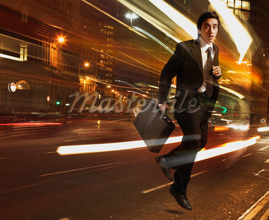 Businessman running with light streaking around him Stock Photo - Premium Royalty-Freenull, Code: 635-02152675
