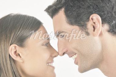 Young adult couple touching noses Stock Photo - Premium Royalty-Freenull, Code: 644-02152893