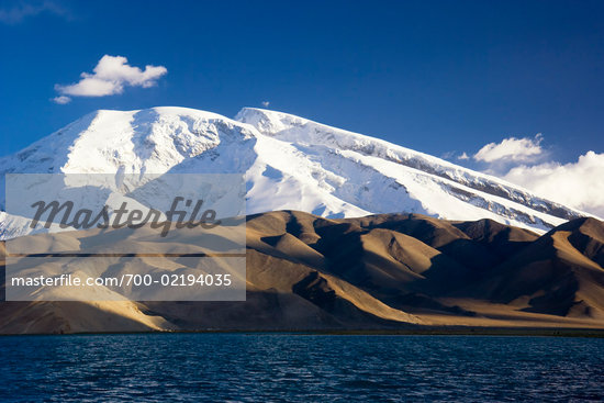 Karakul Lake Pamir Pamir Muztagh Ata by Lake