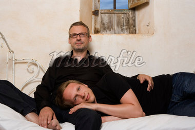 Couple on Bed    Stock Photo - Premium Rights-Managed, Artist: Marie Blum, Code: 700-02198273