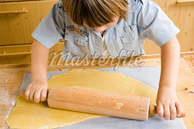 Child rolling out dough Stock Photo - Premium Royalty-Freenull, Code: 659-02212423
