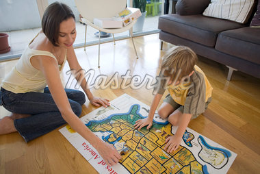 Mother and Son Doing Jigsaw Puzzle    Stock Photo - Premium Royalty-Free, Artist: Raoul Minsart, Code: 600-02222943