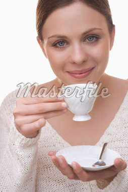Woman Drinking Tea    Stock Photo - Premium Royalty-Free, Artist: Siephoto, Code: 600-02235850
