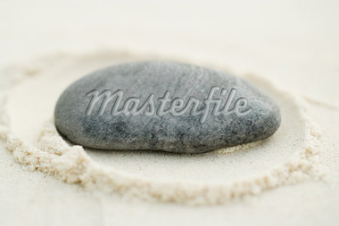 Stone on sand, close-up Stock Photo - Premium Royalty-Freenull, Code: 633-02345751