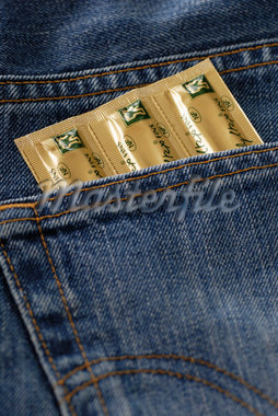 Close-up of Condoms in Jeans Pocket    Stock Photo - Premium Rights-Managed, Artist: Jean-Christophe Riou, Code: 700-02346178