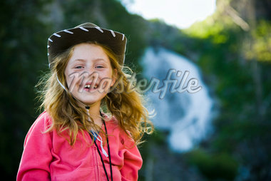 Portrait of Girl Wearing Cowboy Hat, Yellowstone National Park, Wyoming, USA    Stock Photo - Premium Rights-Managed, Artist: Patrick Chatelain, Code: 700-02371222
