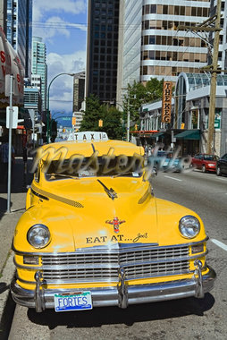 Taxi on Street in Downtown Vancouver, British Columbia, Canada    Stock Photo - Premium Rights-Managed, Artist: Moritz Schönberg, Code: 700-02519102