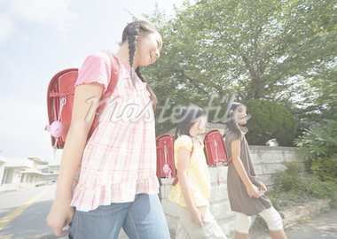Elementary school students commute Stock Photo - Premium Royalty-Freenull, Code: 670-02642725