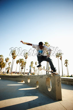 Man Skateboarding    Stock Photo - Premium Rights-Managed, Artist: Nick Onken, Code: 700-02659863