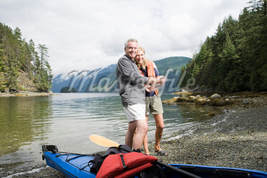 Couple with kayak Stock Photo - Premium Royalty-Freenull, Code: 614-02680123
