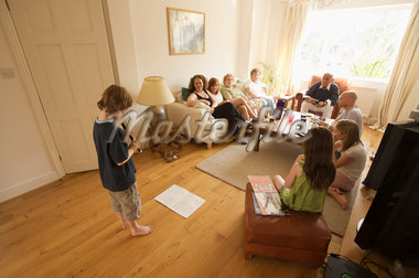 Boy Playing Recorder for Family    Stock Photo - Premium Rights-Managed, Artist: Bruce Fleming, Code: 700-02698330