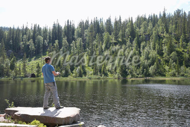 Man Fishing in Lake, Norway    Stock Photo - Premium Rights-Managed, Artist: Anders Hald, Code: 700-02702601