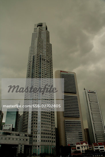 Cityscape against dark gloomy skies Stock Photo - Premium Royalty-Freenull, Code: 656-02702805