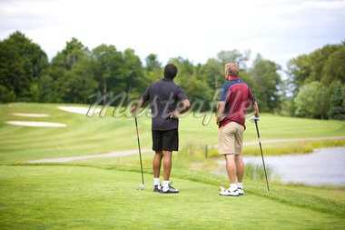 Backview of Men Standing on Golf Course    Stock Photo - Premium Royalty-Free, Artist: Blue Images Online, Code: 600-02751466