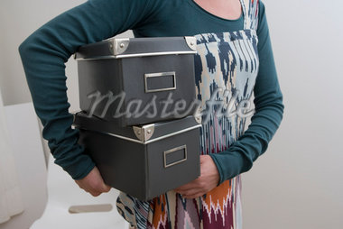 Woman Carrying Boxes    Stock Photo - Premium Rights-Managed, Artist: Marie Blum, Code: 700-02756573