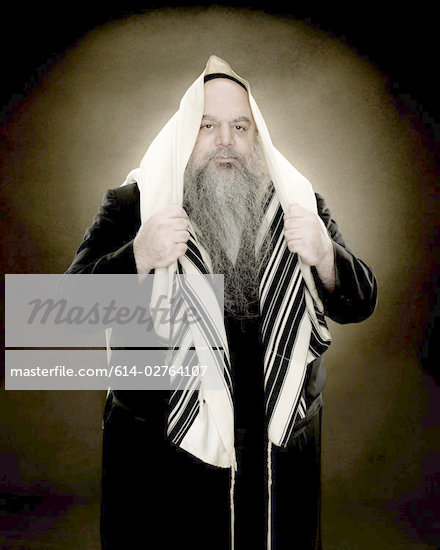 A rabbi wearing a prayer shawl Stock Photo - Royalty-Freenull, Code: 614-02764107