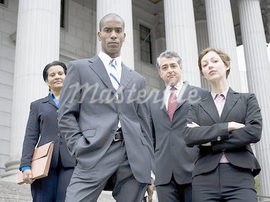 Low angle view of lawyers in front of a courthouse Stock Photo - Premium Royalty-Freenull, Code: 640-02764723