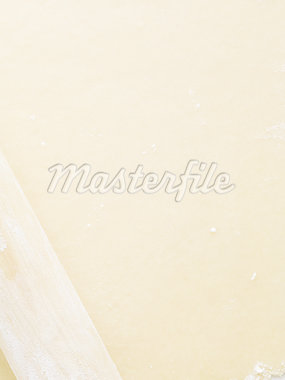 Detailed view of dough with rolling pin Stock Photo - Premium Royalty-Freenull, Code: 640-02772553