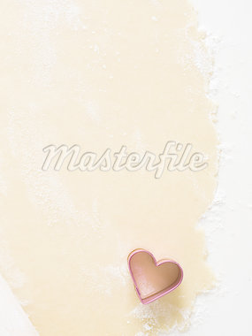 Detailed view of dough with hearts and rolling pin Stock Photo - Premium Royalty-Freenull, Code: 640-02772561