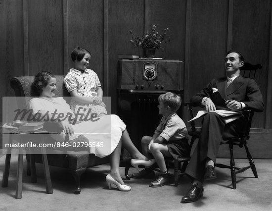 1930s family man father woman mother girl daughter boy son in living room