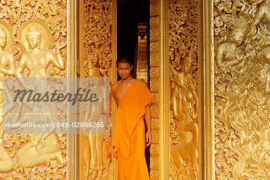 Laos, Luang Prabang, A young monk stands in the doorway of a temple Stock Photo - Premium Rights-Managed, Artist: Asia Images, Code: 849-02866265