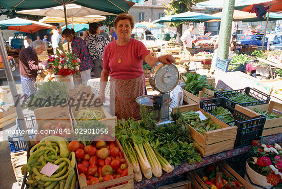 Woman selling fruit, vegetables and flowers on a stall in the street market in Asti, Piedmont, Italy, Europe Stock Photo - Direito Controlado, Artist: Robert Harding Images, Code: 841-02901056