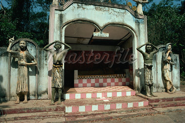 Guardian figures including Christ and Virgin Mary on Animist grave near Takikroum on frontier with Ivory Coast, Ghana, West Africa, Africa Stock Photo - Premium Rights-Managed, Artist: Robert Harding Images, Code: 841-02901463