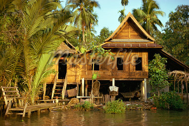 A traditional Thai house on stilts above the river in Bangkok, Thailand, Southeast Asia, Asia Stock Photo - Premium Rights-Managed, Artist: Robert Harding Images, Code: 841-02902076