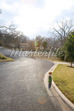 Boy Standing near Curb of Neighborhood Street, Austin, Texas, USA Stock Photo - Premium Rights-Managed, Artist: Mark Peter Drolet, Code: 700-02912121