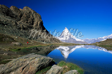 Matterhorn reflected in the Riffelsee, near Rotenboden, Zermatt, Valais, Swiss Alps, Switzerland, Europe Stock Photo - Premium Rights-Managed, Artist: Robert Harding Images, Code: 841-02920490