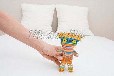 Man Holding a Toy                                                                                                                                                                                        Stock Photo - Premium Rights-Managed, Artist: Marie Blum               , Code: 700-02935681