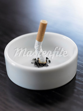Stubbed out cigarette in ashtray Stock Photo - Premium Royalty-Freenull, Code: 635-03015395