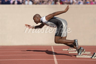 Sprinter Leaving the Starting Blocks                                                                                                                                                                     Stock Photo - Premium Rights-Managed, Artist: Aflo Sport               , Code: 858-03050061