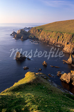Cliffs of Hermaness Nature Reserve, looking north towards Vesta Skerry, Tipta Skerry gannetry, Muckle Flugga and its lighthouse in the distance, Unst, Shetland Islands, Scotland, United Kingdom, Europe Stock Photo - Premium Rights-Managed, Artist: Robert Harding Images    , Code: 841-03064347