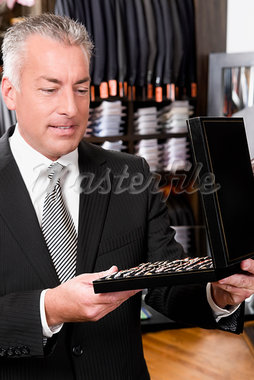 Customer shopping in a clothing store                                                                                                                                                                    Stock Photo - Premium Rights-Managed, Artist: Glowimages               , Code: 837-03071167