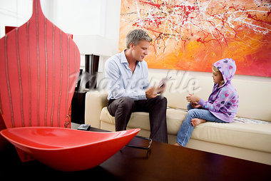 Man playing cards with his daughter                                                                                                                                                                      Stock Photo - Premium Rights-Managed, Artist: Glowimages               , Code: 837-03074629