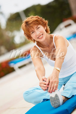 Woman Stretching Stock Photo - Premium Royalty-Free, Artist: Marc Vaughn, Code: 600-03227498