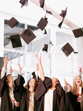 Graduates throwing mortarboards in air Stock Photo - Premium Royalty-Freenull, Code: 635-03228689