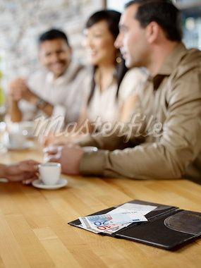 Friends Paying Bill at Wine Bar, Toronto, Ontario, Canada Stock Photo - Premium Royalty-Free, Artist: Matthew Plexman, Code: 600-03230235