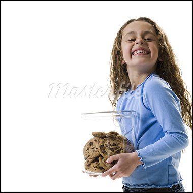 Young girl holding cookie jar Stock Photo - Premium Royalty-Freenull, Code: 640-03265224