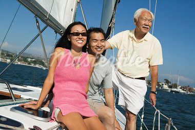 Family on sailboat Stock Photo - Premium Royalty-Freenull, Code: 694-03318235