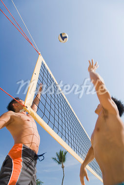 Two Men Playing Volleyball Stock Photo - Premium Royalty-Free, Artist: Marcus Mok, Code: 600-03333270