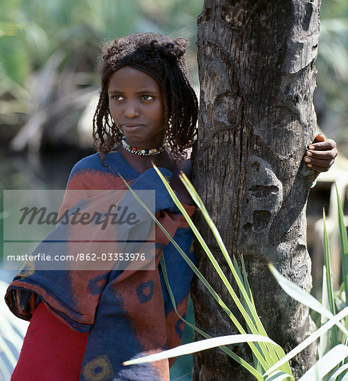 A young Afar girl at Filwoha in the Awash National Park. Filwoha in the Afar language means 'hot water'. The beautiful springs are surrounded by doum palms and rise from deep underground at about 96.8 degrees F. Stock Photo - Rights-Managed, Artist: AWL Images, Code: 862-03353976