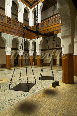 The interior of the Nejjarine Museum of Wooden Arts and Crafts in Fez,Morocco. Opened in 1998 it is housed in a beautifully restored 'funduq',a caravanserai for travelling merchants. They stored and sold their goods below and stayed in the rooms above. Stock Photo - Premium Rights-Managed, Artist: AWL Images, Code: 862-03364622